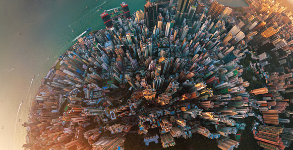 Little planet. Aerial view of Hong Kong Downtown. Financial district and business centers in smart city in Asia. Top view. Panorama of skyscraper and high-rise buildings. 1044815792
