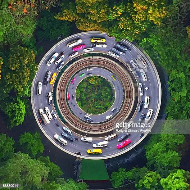 Little Planet Effect Of Vehicles On Highway Amidst Trees