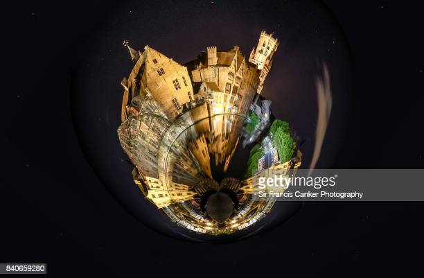 Little planet format of Bruges Belfry and Rozenhoedkaai canal illuminated at night in Flanders, Belgium