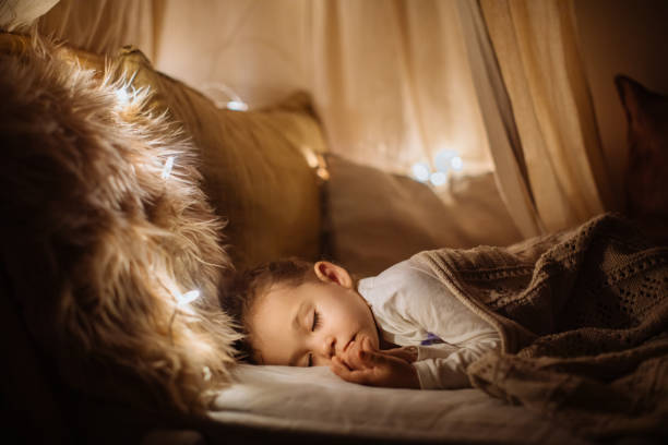 little preschool girl sleeping in comfortable bed - child sleeping in bed stock pictures, royalty-free photos & images