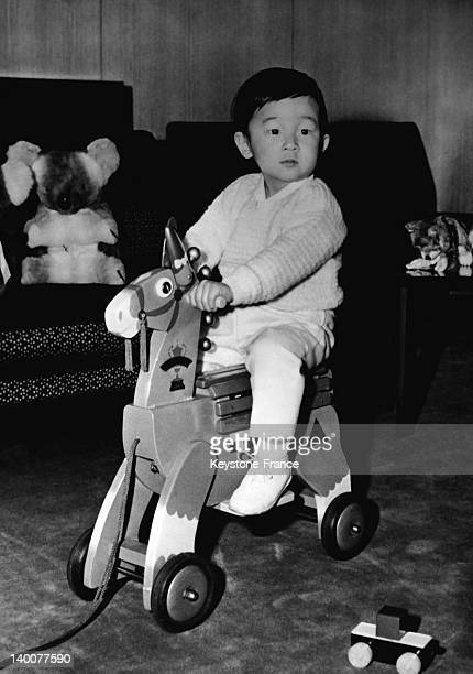 Little Prince Naruhito baby son of crown prince Akihito riding his rocking horse in the sixties in Tokyo Japan