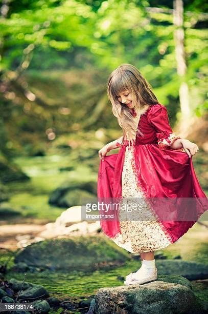 Little princess crossing the stream