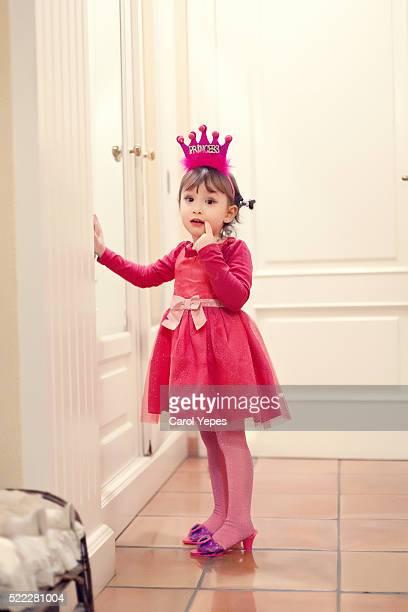 little princess with pink tutu indoors
