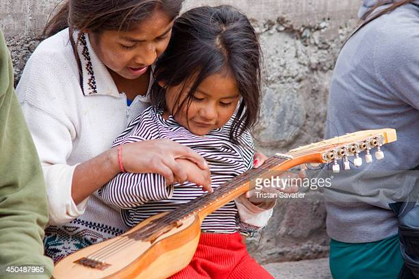 CONTENT] Little Quechua girls playing with a charango an Andean lute instrument in Iruya Iruya is a beautiful but very remote village in the Quebrada...