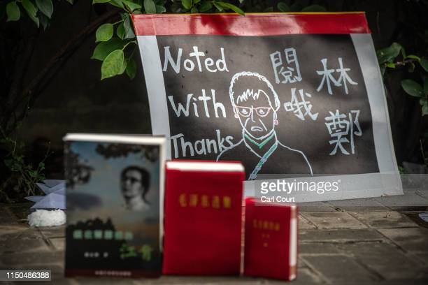 Little Red Books are placed next to a protest poster by the Legislative Council building on June 18 2019 in Hong Kong Hong Kongs Chief Executive...