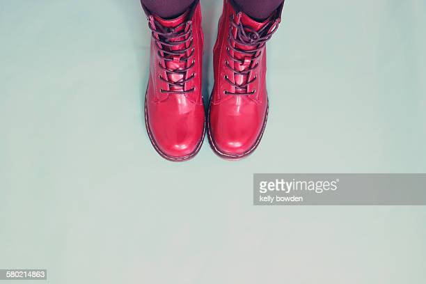 little red boots - leather boot stock pictures, royalty-free photos & images
