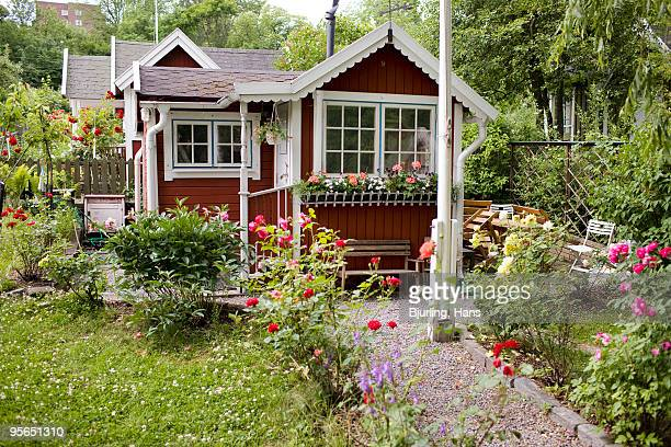 a little red cottage, sweden. - cottage exterior stock pictures, royalty-free photos & images