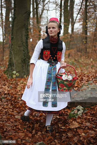 Little Red Riding Hood actually actress Dorothee Weppler wears the local Schwalm region folk dress with its red cap as she walks through a forest on...