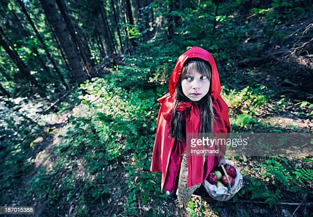Little Red Riding Hood in dark forest
