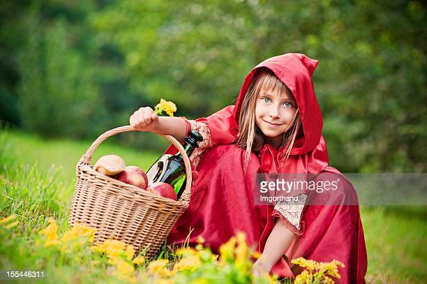 Little Red Riding Hood picking up flowers