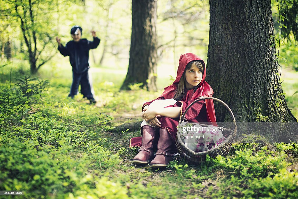 Little Red Riding Hood resting : Stock Photo
