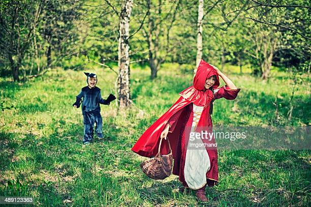 Little Red Riding Hood running from the wolf