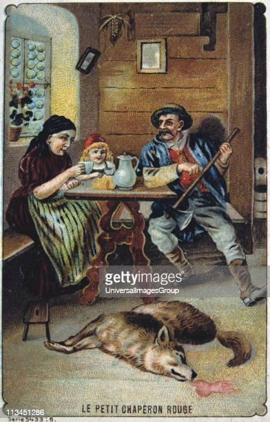 Little Red Riding Hood safe with her grandmother and the woodsman who has killed the wolf French trade card c1900 illustrating the fairy tale by the...