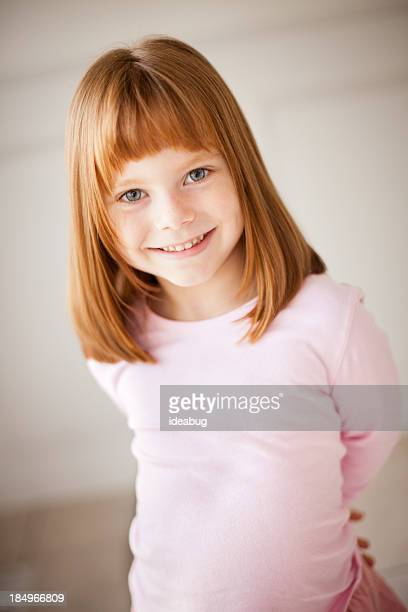 little red-haired girl smiling at the camera - redhead girl stock photos and pictures