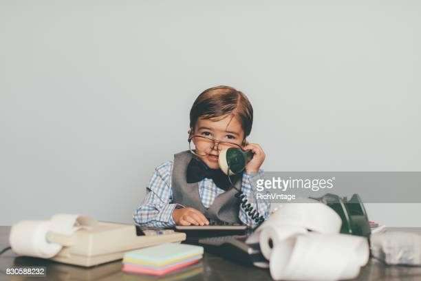 Little Retro Business Boy Works the Phone