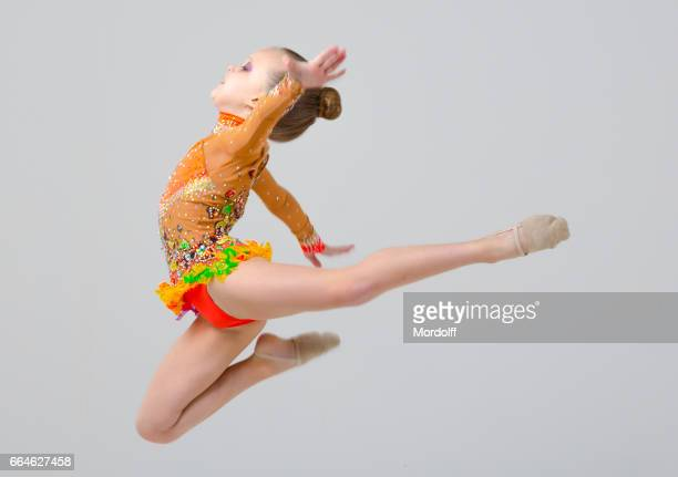 little rhythmic gymnast performing jump - little girls doing gymnastics stock photos and pictures