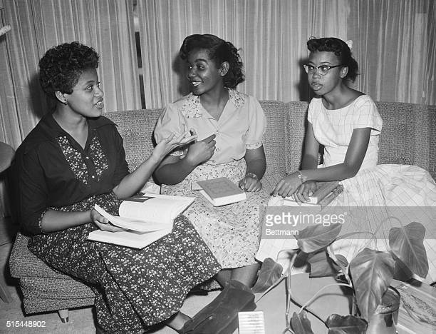 9/25/1957 Little Rock AK Elated after spending their first full day at Little Rock Central High three of the nine Negro students escorted to classes...