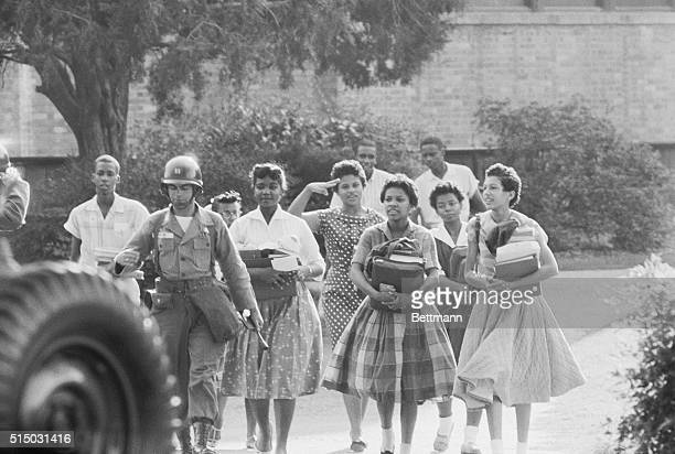 Little Rock, Arkansas: The nine Negro students leave Little Rock's Central High School after finishing another school day.