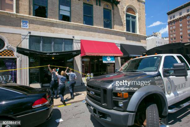 Little Rock Police Department detectives and crime scene personnel collect evidence at the Ultra Power Lounge on July 1 2017 in Little Rock Arkansas...
