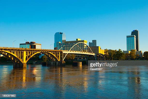 little rock skyline, river, and bridge - arkansas stock photos and pictures