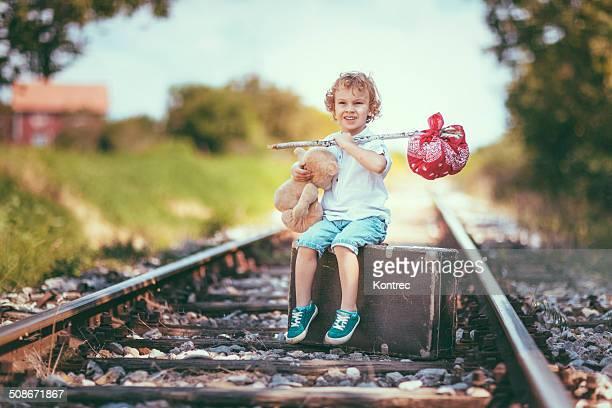 Little runaway boy running away from home