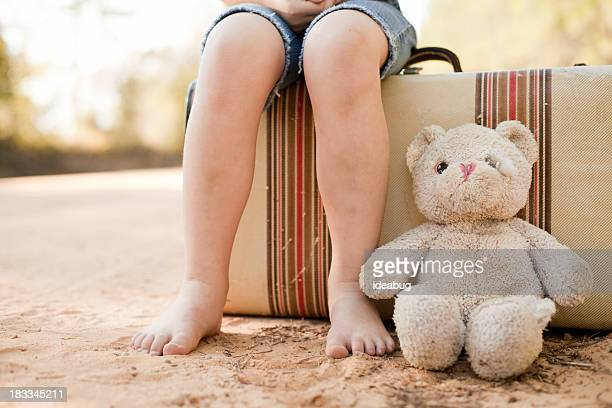 Little Runaway or Homeless Girl with Suitcase and Teddy Bear