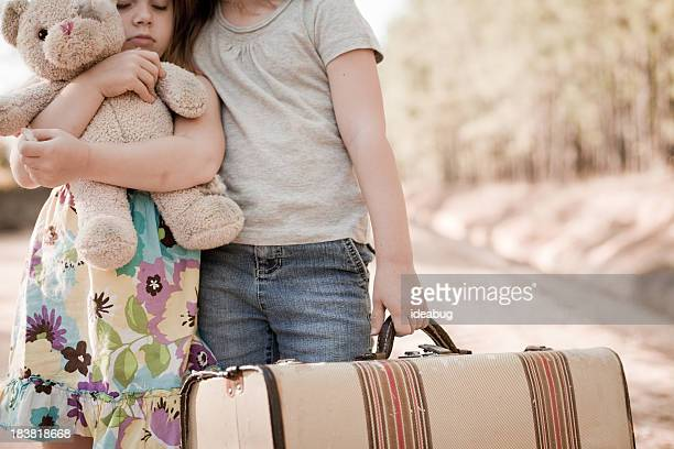 Little Runaway or Homeless Girls with Suitcase and Teddy Bear