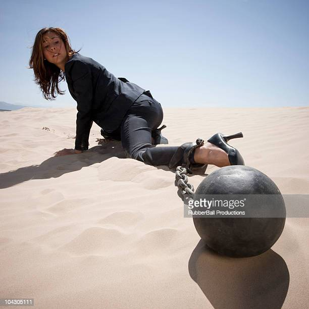Little Sahara,Utah,USA,Woman crawling through the desert with a ball and chain