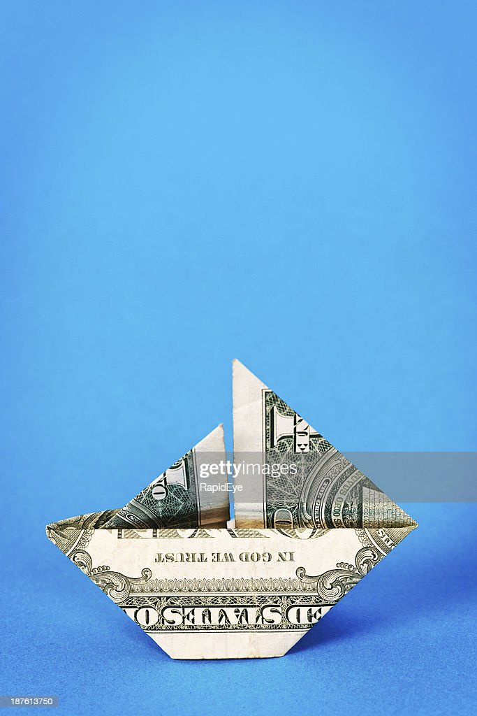 Origami boat made of dollar bill isolated on white background ... | 1024x683