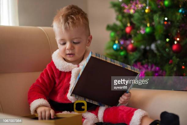 Little Santa Claus opening gift