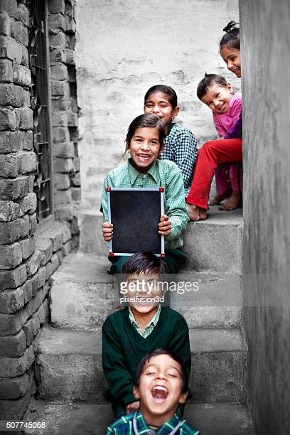 little school students portrait at home holding chalkboard - girls stock pictures, royalty-free photos & images