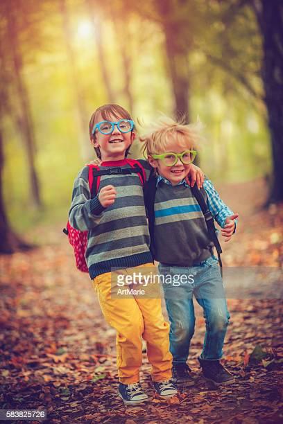 Little schoolboys in autumn