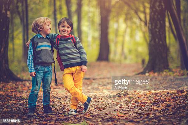 Little schoolboys in autumn
