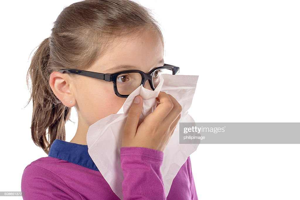 little schoolgirl has a cold : Stock Photo
