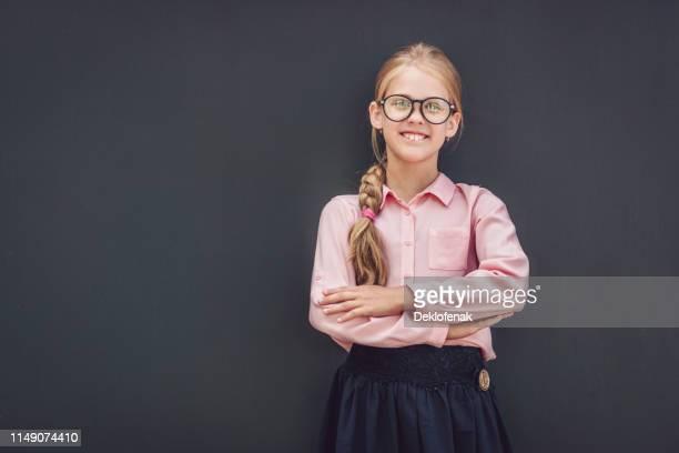 little schoolgirl black background