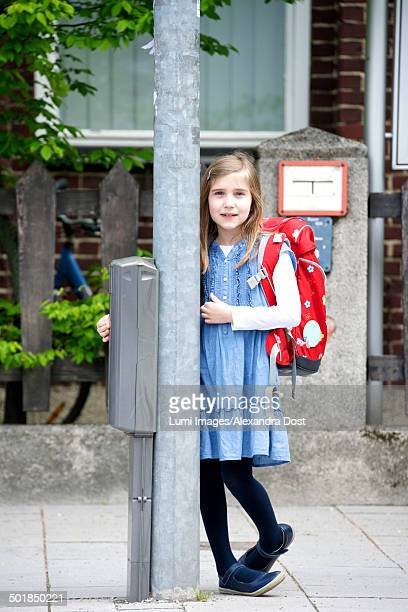Little schoolgirl with blond hair waiting at a stoplight, Munich, Bavaria, Germany