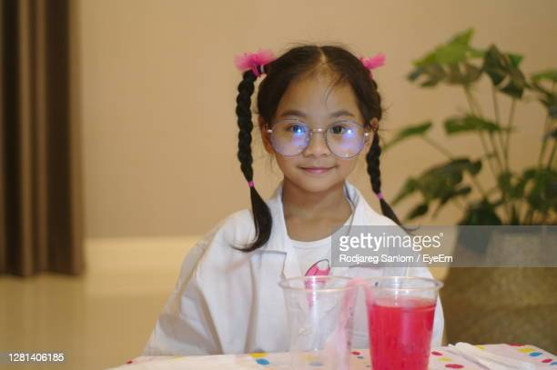 little scientist doing some experiments - 4 girls finger painting stock pictures, royalty-free photos & images