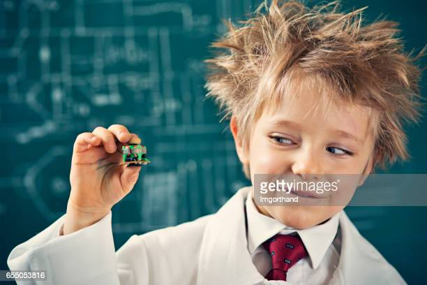 Little scientist holding a miniaturization invention
