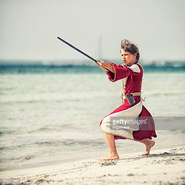 little shieldmaiden practicing - girl fight stock photos and pictures