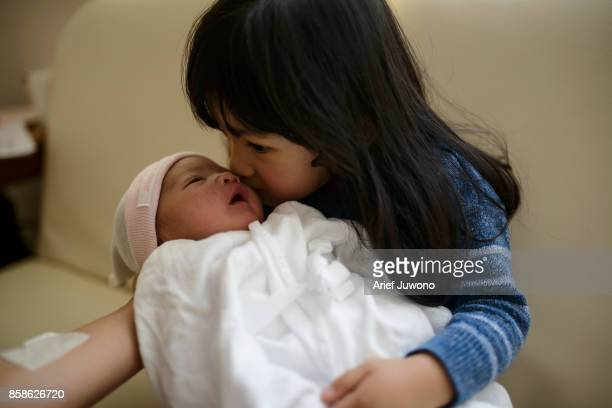 little sister born - japanese girls hot stock photos and pictures