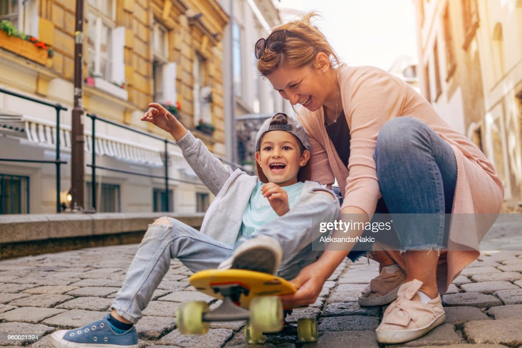 Little skateboarder and his mom : Stock Photo