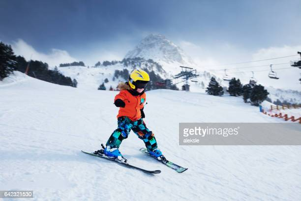 Little skier racing in snow