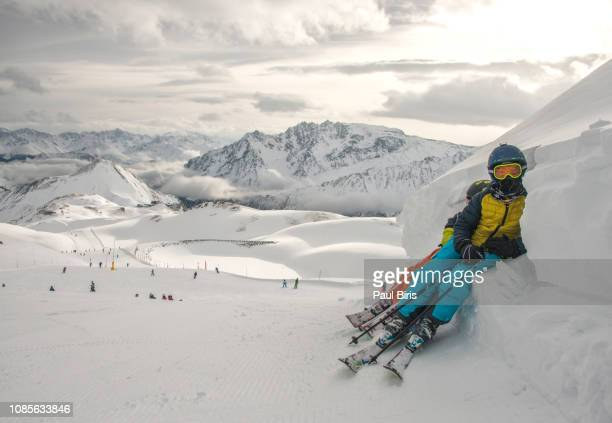 little skiers resting on a beautiful winter day,  ischgl silvretta arena resort, austria - winter sports event stock pictures, royalty-free photos & images