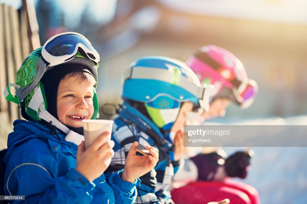 Little skiers resting on a beautiful winter day : Stock Photo