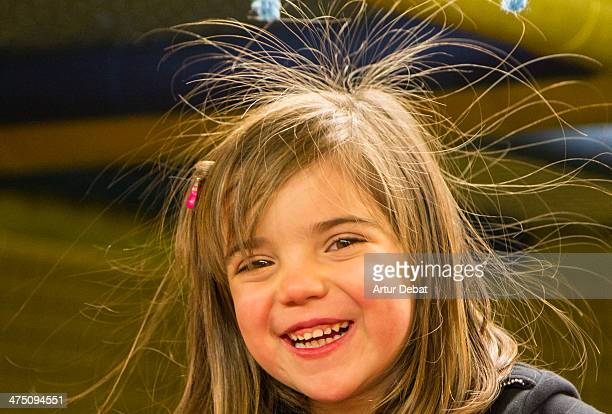 Little smiley girl with static electricity on hair
