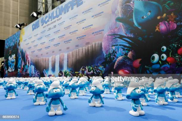 Little smurfs in front of the photo wall during the 'Die Schluempfe Das verlorene Dorf' premiere at Sony Centre on April 2 2017 in Berlin Germany