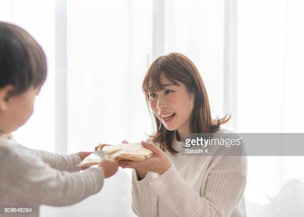 little son giving present to mother - woman giving birth stock photos and pictures