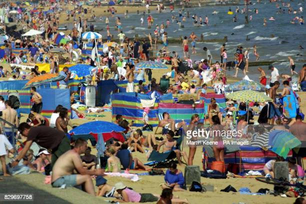 Little space to spare on the beach at Branksome in Poole Dorset where thousands flocked to escape soarng temperatures