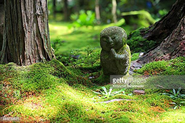 CONTENT] A little statuette of Buddha in the beautiful garden of Sanzenin Temple in Ohara Kyoto
