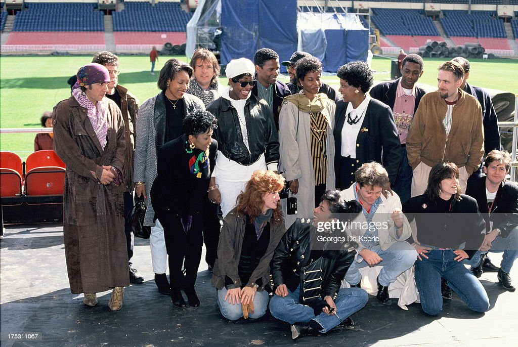 Little Steven, Bonnie Raitt, Chrissie Hynde, Anita Baker, Natalie Cole, Patti LaBelle, Winnie Mandela, Peter Gabriel, Mica Paris, Lou Reed, Jim Kerr and Denzel Washington attend backstage a concert held at Wembley Stadium to celebrate the release of African National Congress (ANC) leader Nelson Mandela from prison on April 16, 1990 in London, England.